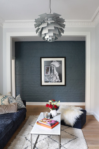 Photo portrait of Native American on grey wall in living room