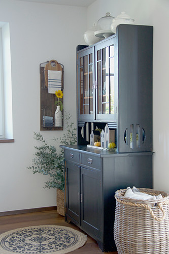 Grey dresser in country-house style in dining room