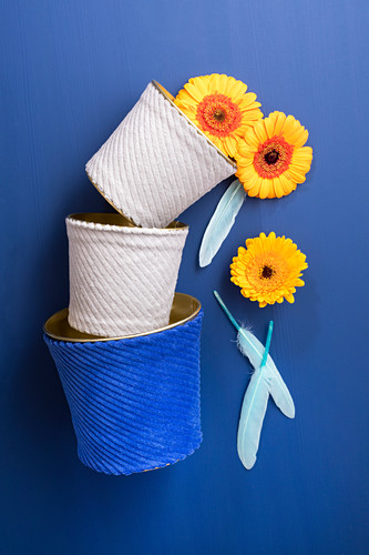 Cache pots or organisers decoratively covered in corduroy