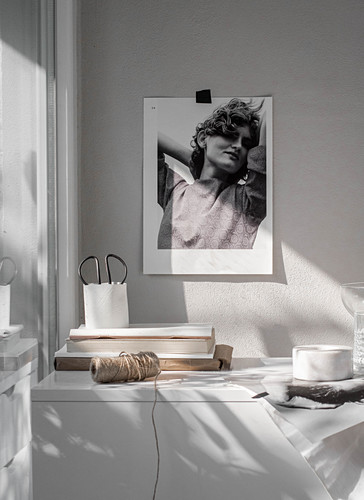 Black-and-white photograph above low sideboard