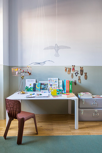 Bird mobile and table lamp decorated with bird ornaments on children's table