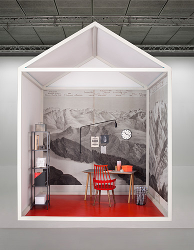 Creative design for study area with desk against wall covered in mural wallpaper with mountain motif