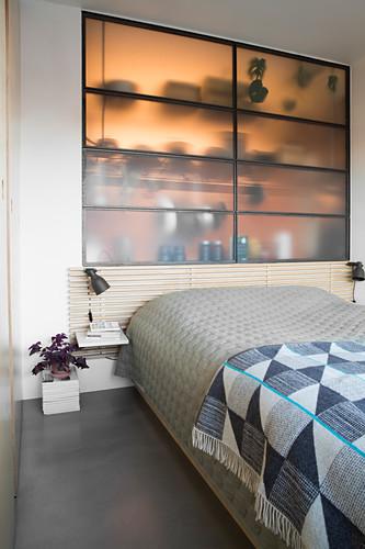 Translucent interior window between bedroom and kitchen