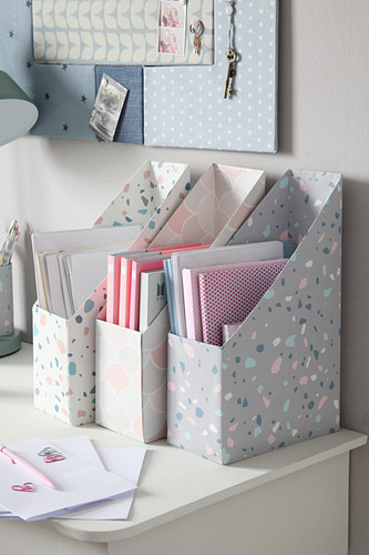 DIY box files on desk below pinboard on wall