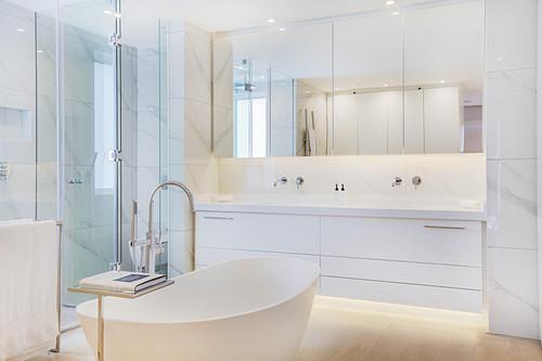 Ceramic tiles in white designer bathroom