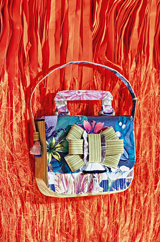 Composition of materials and fabrics in shape of a handbag