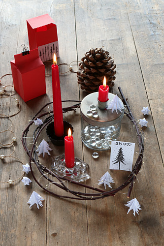 Festive arrangement with red candles in wreath of twigs