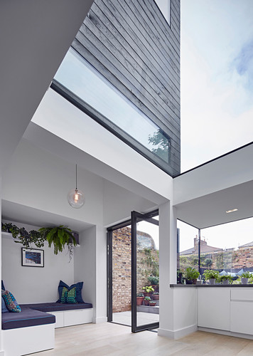 Three-storey architect-designed house with black wood cladding and glass elements