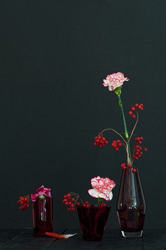 Modern arrangement of carnations and berries