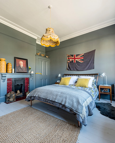 Bedroom with grey walls and mustard-yellow accents