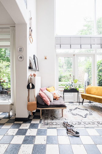 Chequered floor and glass wall in open-plan interior