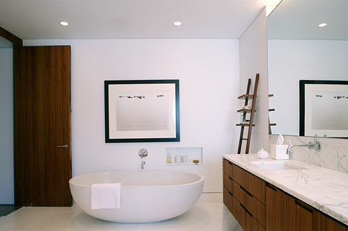 Free-standing bathtub and washstand with marble top in elegant bathroom