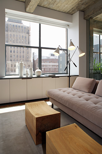 Pale sofa and coffee table below window