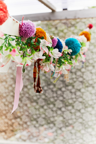 Garland of pompoms, fabric remnants and fabric flowers