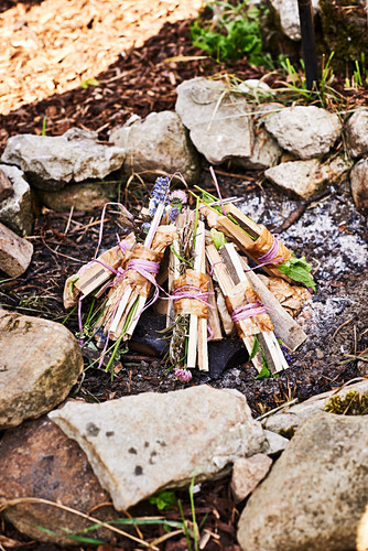 Bundles of kindling and herbs tied with raffia