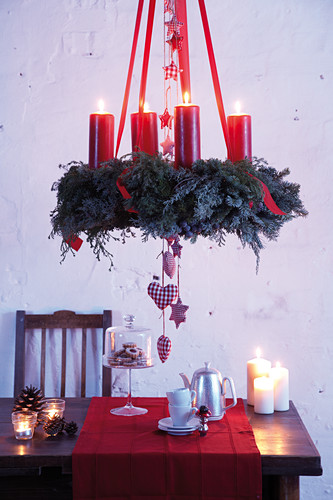 Suspended Advent wreath with red pillar candles