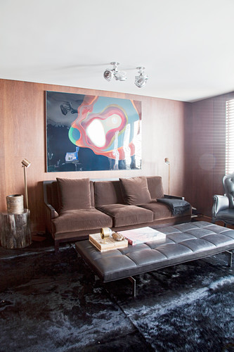Brown sofa and black leather ottoman in living room