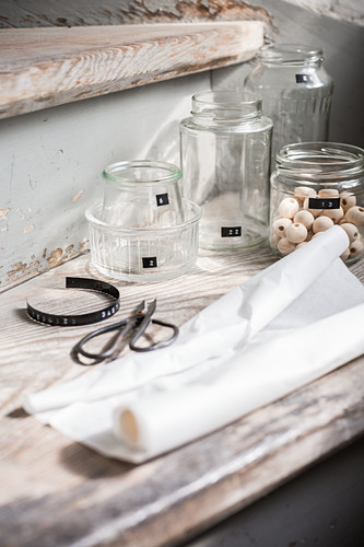 Materials for making Advent calendar from recycled jars