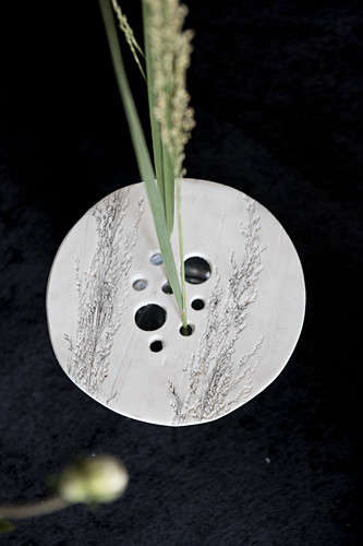 Perforated vase lid handmade from modelling clay