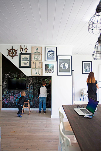 Open living space, children draw on the wall with blackboard paint