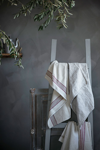 Tea towels hanging on ladder