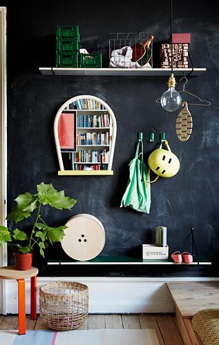 DIY coat rack made from shelves on black wall