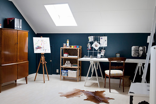 Desk and easel in attic study