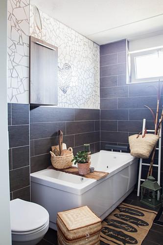 Bathtub with bath caddy and toilet in bathroom