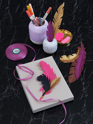 Homemade paper feathers as a gift and desk decoration