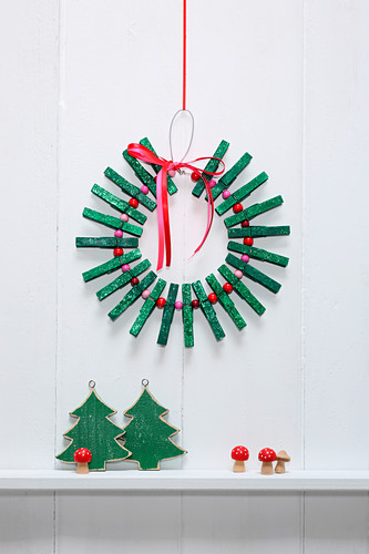 Christmas wreath made from green-painted clothes pegs