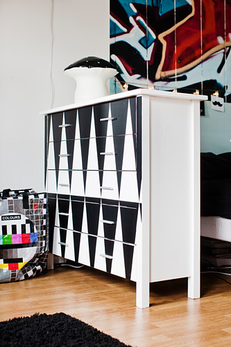 White cabinet decorated with black adhesive film