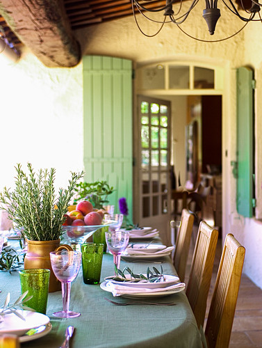 Table set for lunch on terrace (Provence, France)