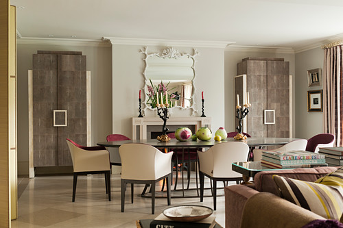 Dining chairs around dining table in dining area with pair of bespoke shagreen covered cabinets