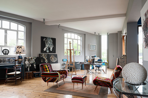 Kilim chairs in open-plan studio with grey walls