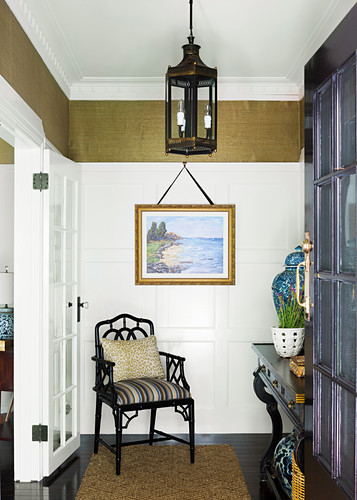 Colonial hallway with cassette walls