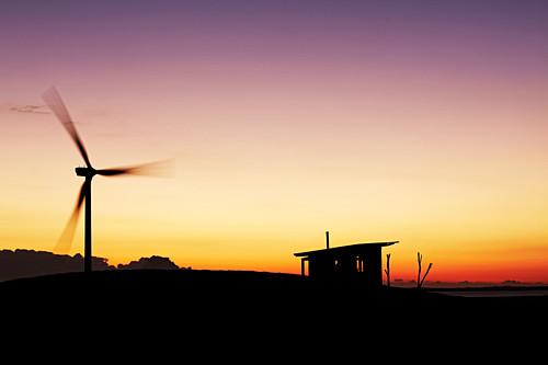 Pinwheel and hut at sunset