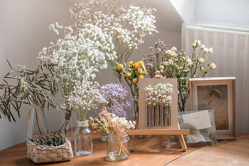Arrangement of dried flowers on table