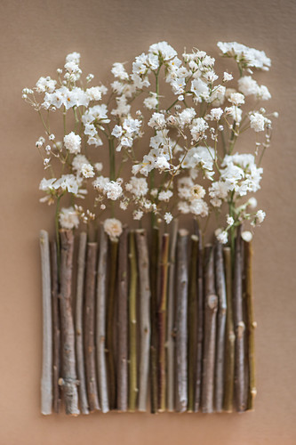 Decoration: handcrafted garden fence of tiny twigs and dried flowers