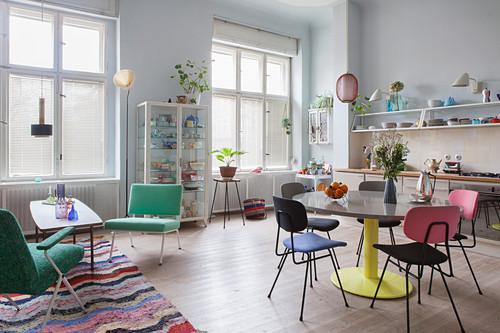 Colourful retro furniture in open-plan period interior