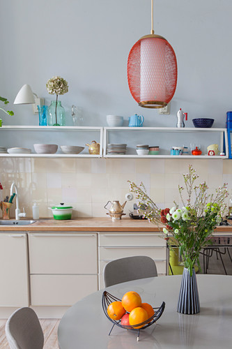 View across dining table to retro-style kitchen counter