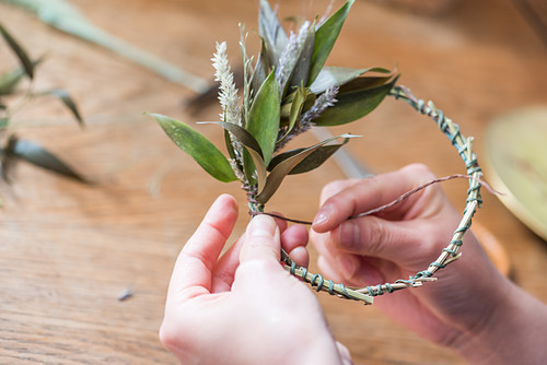 Hand-tied wreath of dried leaves, flowers and grasses