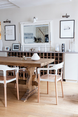 Modern chairs around rustic wooden table in dining room