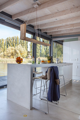 Modern houseboat: kitchen counter, wooden ceiling and glass wall