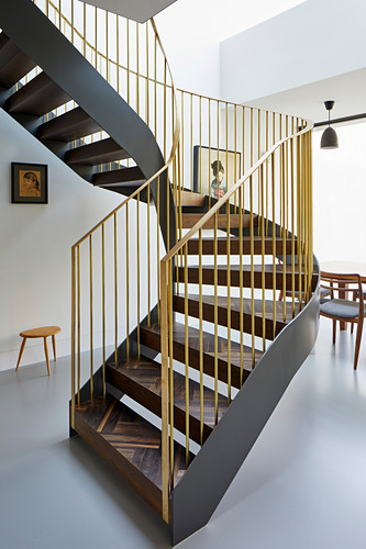 Spiral staircase with inlaid treads and gold balustrades