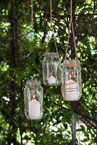 DIY candle lanterns hung from tree