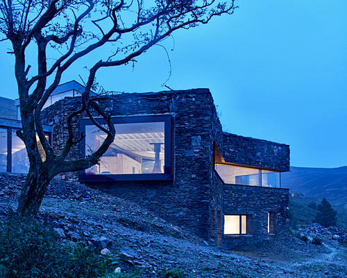 Modern architect-designed house integrated into landscape