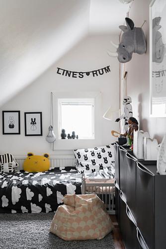 Black-and-white child's bedroom in attic