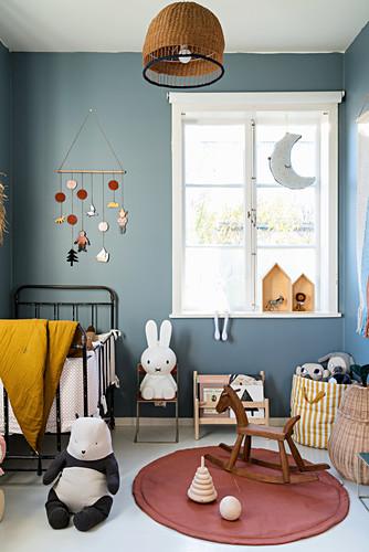 Vintage-style nursery with blue-grey walls