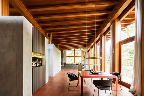 Dining table and bar in sustainable, architect-designed house
