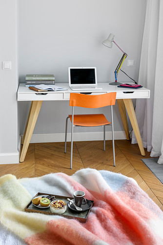 Breakfast tray on bed and desk in bedroom